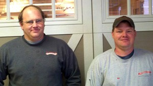 Eric Richter, left, and Bill Chapek, recently received their rolling steel fire door technician certification. Richter and Chapek are employees of Overhead Door Company of Albert Lea. -- Submitted