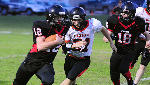 Alden-Conger quarterback, Brady Neel, tries to turn the corner in the first quarter against Madelia. The Knights lost 44-14. — Micah Bader/Albert Lea Tribune