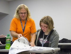 Cindy Jones helps Krystal Casey during class on Tuesday at Riverland Community College. The students are part of Albert Lea School District but meet for class at the college.