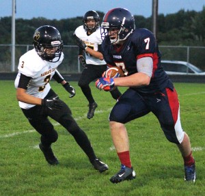 Albert Lea halfback Triston Westerlund rushes for a touchdown Friday night against Mankato East. Westerlund finished with 39 yards on 11 carries. He also completed a 50-yard pass at the end of regulation to Cody Scherff. — Drew Claussen/Albert Lea Tribune