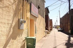 The back side of the historic Bessesen building was one of a few painted Saturday in an effort by the Freeborn County Arts Initiative to clean up a downtown alley. -- Sarah Stultz/Albert Lea Tribune