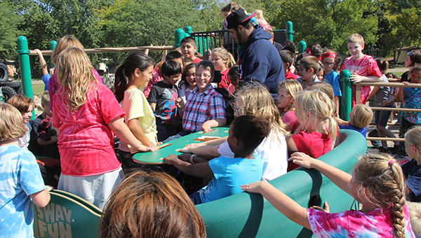 """Hunter Johnson, 12, plays with other children on a big saucer called """"Sway Fun"""" Thursday at Halverson Elementary School. -- Tim Engstrom/Albert Lea Tribune"""