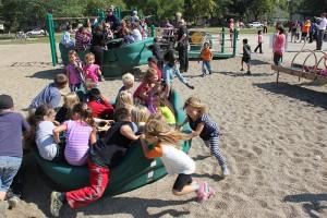 Halverson Elementary School students play on new playground equipment Thursday. -- Tim Engstrom/Albert Lea Tribune