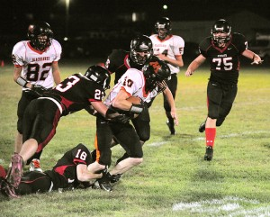 The Alden-Conger defense swarms a Madelia ball carrier Friday on the Knights' Homecoming. The Knights held Madelia's offense in check through the first three quarters. — Micah Bader/Albert Lea Tribune