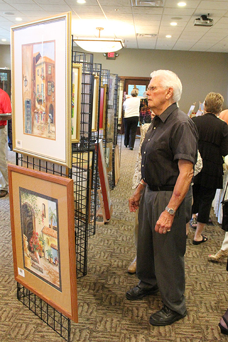 People browse through more than 100 pieces by painter Barb Butler. Butler was the featured artist at the Celebrating the Arts & Artists event, a fundraiser for the Albert Lea Art Center.