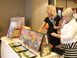 Sisters Sue Loch and Julie Johnson browse during the Celebrating the Arts & Artists event on Friday.