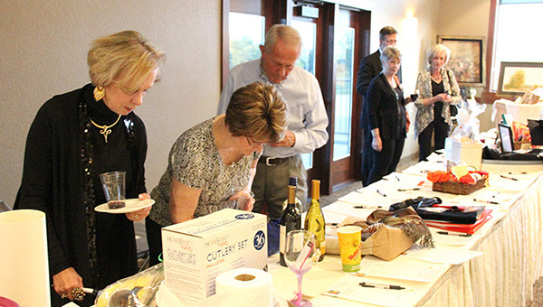 People look at various silent auction items during a fundraiser for the Albert Lea Art Center. The event started at 5 p.m. at Wedgewood Cove Golf Club. -- Kelli Lageson/Albert Lea Tribune