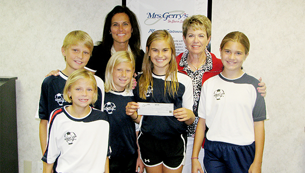 Mrs. Gerry's donated $10,000 toward the Edgewater soccer complex project. The complex is designed to fit up to six fields of various sizes. Front row from left are Nora Pleimling, Annie Pleimling, Lucy Sherman and Ally Rasmussen. Back row from left are Max Pleimling, Stephanie Sherman and Gerry Vogt. — Submitted