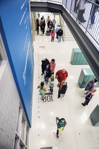 People wander throughout I.J. Holton Intermediate School Saturday during an open house for the new school.