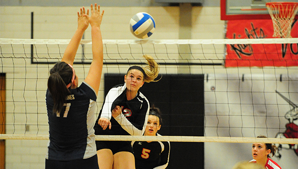 Brooke Reyerson of Alden-Conger spikes the ball over the net Monday against Glenville-Emmons. The Knights won 3-0. — Micah Bader/Albert Lea Tribune