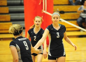Madi Ziebell, right, is congratulated by Anna Severtson, middle, and Bre Lundmark, left, while the Wolverines led 11-9 in Game 3. — Micah Bader/Albert Lea Tribune