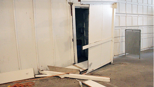 The partition to one of the bathrooms underneath the Grandstand at the Freeborn County Fairgrounds was damaged Saturday night after someone reportedly broke into the building and drove golf carts into walls. -- Sarah Stultz/Albert Lea Tribune