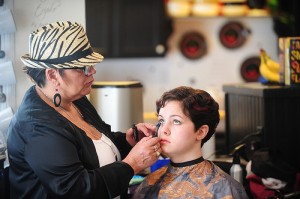 """Lake Mills resident Gretchen Joy Skellenger has her makeup done by Franci Sciorrotta at the Razzy Retreat in Lake Mills for the filming of """"After Life"""" earlier this year. -- Brandi Hagen/Albert Lea Tribune"""