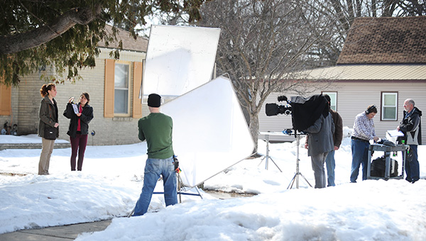 """A film crew shoots a scene in Lake Mills on March 27 at the home of Donna Lair. The crew shot scenes several days in Lake Mills for the film """"After Life."""" -- Brandi Hagen/Albert Lea Tribune"""