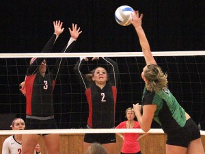 New Richland-Hartland-Ellendale-Geneva's Carlie Wagner, left, and Marnie Wagner attempt to block a spike during Thursday night's home loss to Waterville-Elysian-Morristown. — Drew Claussen/Albert Lea Tribune
