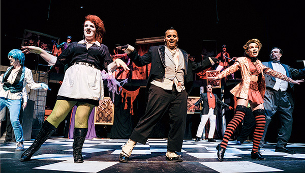 """Emma Waters as Magenta, from left, Tyler Slack as Riff Raff and Jannel Howard as Columbia do the """"Time Warp"""" during rehearsal for """"The Rocky Horror Show"""" Wednesday night at Frank W. Bridges Theatre in Austin. --Eric Johnson/Albert Lea Tribune"""