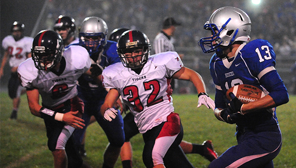 Albert Lea's Levi Hanson, left, is blocked in the back while Emmit Stevens, middle, pursues Owatonna's Aaron Peterson. Owatonna won 23-0 after lightning was spotted 5 minutes and 53 seconds into the game. — Micah Bader/Albert Lea Tribune