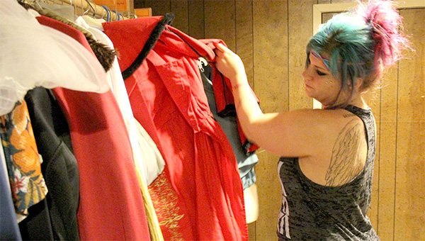 Angel Hogate, employee of Hallow's Eve costume shop, looks through costumes Friday. The shop, which features costumes purchased from the former Courtly Manor, opened Monday in advance of the Halloween holiday. --Sarah Stultz/Albert Lea Tribune
