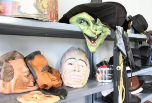 Masks sit on a shelf at Hallow's Eve costume shop, 221 S. Washington Ave., on Friday.