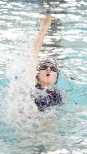 Albert Lea's Bailey Sandon swims the backstroke of the 200-yard medley relay Saturday during the Austin Invitational. — Eric Johnson/Albert Lea Tribune