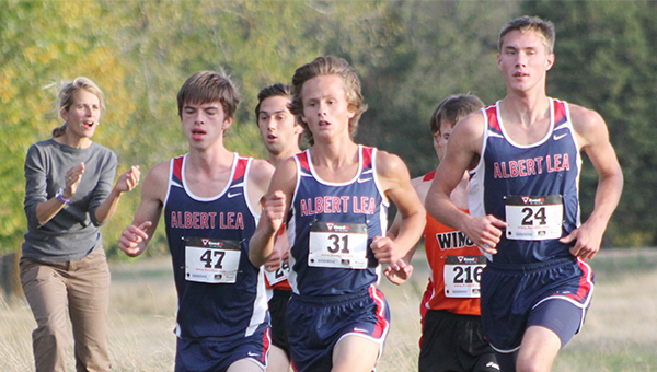A trio of Albert Lea cross country runners compete Tuesday at River Oaks Golf Course in Austin. From left are Albert Lea's Caleb Troe, Jackson Goodell and Blair Bonnerup. All three runners finished in the top 10. — Lon Nelson/For the Albert Lea Tribune