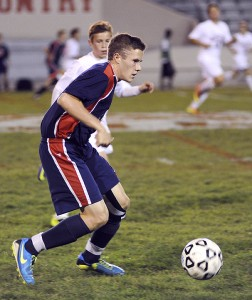 Albert Lea's Carter Dahl moves the ball during the first half of the Section 2A quarterfinals against Austin in Austin Thursday night. — Eric Johnson/Albert Lea Tribune