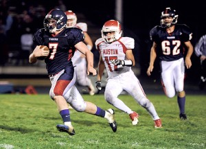Albert Lea quarterback Triston Westerlund breaks a run in the third quarter against Austin in Albert Lea.  Westerlund carried the ball 28 times for 105 yards and two touchdowns. He also threw for two scores. — Eric Johnson/Albert Lea Tribune