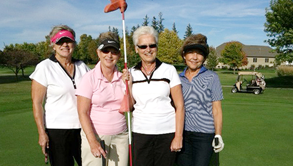 Ginny Thompson hit a hole-in-one on hole No. 6 at Rice Lake Golf Club on Tuesday. From left are Joni Rowe, Jane Lodge, Thompson and Jeanne Schermer. — Submitted