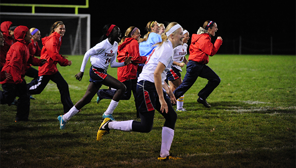 The Albert Lea girls' soccer team erupts off the bench after Holly Wichmann made the game-winning penalty kick Saturday against Mankato Loyola in the Section 2A quarterfinals. Albert Lea won 4-2. — Micah Bader/Albert Lea Tribune
