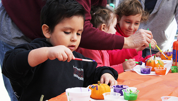 Marley Lugo, 4, focuses as he paints a pumpkin Saturday at Celebrate Albert Lea on Broadway. The event was set up to celebrate the near-completion of the Broadway reconstruction. --Sarah Stultz/Albert Lea Tribune