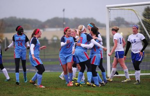 The Albert Lea girls' soccer team celebrates scoring its first goal of the evening on a deflection in a 3-1 win Tuesday at Waseca/New Richland-Hartland-Ellendale-Geneva/Janesville-Waldorf-Pemberton. — Micah Bader/Albert Lea Tribune