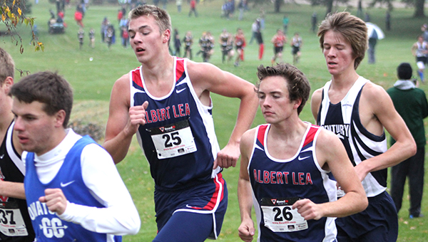 Brandon Bonnerup, left, and Logan Callahan of Albert Lea run Tuesday during the Big Nine Conference Meet at Brooktree Golf Course in Owatonna. The Albert Lea boys' team took fourth place, and the girls took second. — Lon Nelson/For the Albert Lea Tribune