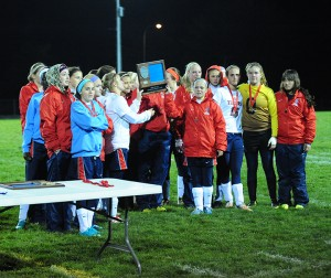 The Albert Lea girls' soccer team holds the Section 2A runner up plaque Friday after losing 1-0 to Mankato West in a shootout. The Tigers were 13-6-1 overall. — Drew Claussen/Albert Lea Tribune