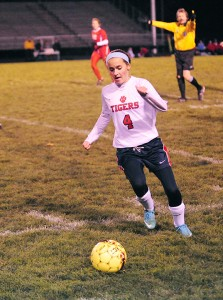 Claire Sherman of Albert Lea dribbles the ball up the field Friday during the Section 2A final at Jim Gustafson Field against Mankato West. — Drew Claussen/Albert Lea Tribune