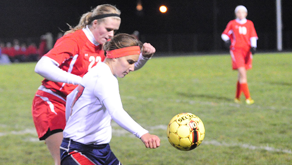 Holly Wichmann of Albert Lea battles a defender from Mankato West for possession of the ball during Friday night's 1-0 loss in the Section 2A finals at Jim Gustafson Field. — Drew Claussen/Albert Lea Tribune