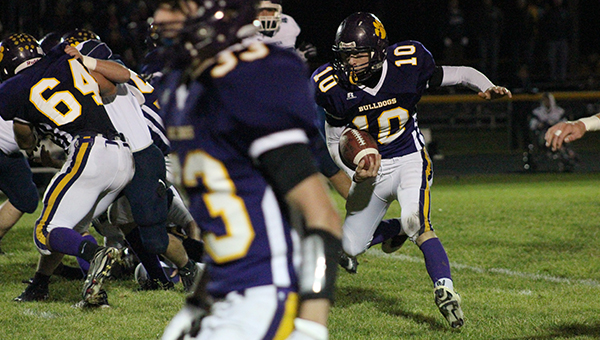Jonah Ringham of Lake Mills carries the ball Friday against Ackley-Geneva-Wellsburg-Steamboat Rock. Ringham earned 26 yards on three carries. — Micah Bader/Albert Lea Tribune