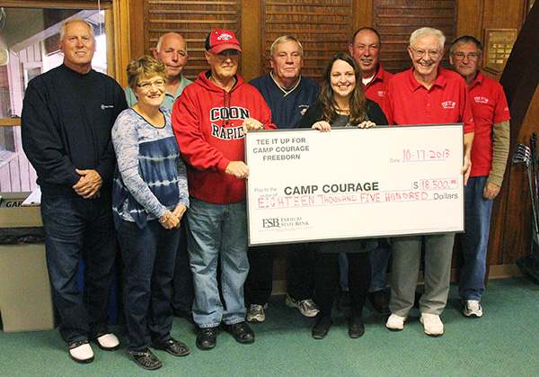 A Freeborn area fundraising committee that runs a July golf outing hands a check for $18,500 to Camp Courage Thursday at Oak View Golf Course. From left are John McKean,  Sue Boeck, Ron Boeck, Dan Jaspersen, Les Honstad, Cathy Braaten of Camp Courage, Jim Beach, Neil Pierce and Shorty Jensen. -- Tim Engstrom/Albert Lea Tribune