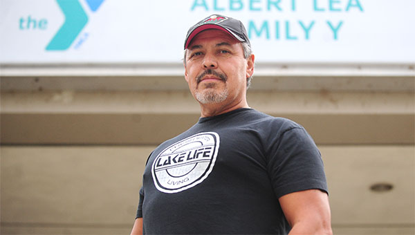 Bill Villarreal, a retired police officer, stands in front of the Albert Lea Family Y, where he works as a group and personal training specialist. --Micah Bader/Albert Lea Tribune