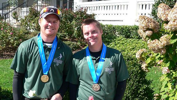 Brothers Devin Kaasa, left, and Kellen Kaasa of Glenville wear gold medals they won by taking first place out of 34 teams in their division at the Special Olympics North America Golf Invitational at Stockton Seaview Hotel & Golf Club in Galloway N.J. The event was Friday through Sunday. — Submitted