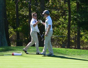 Kellen Kaasa, left, fist-bumps his brother, Devin. The duo was unstoppable at the Special Olympics North American Golf Invitational. In three rounds of play, the Kaasa brothers' score was 138. They beat the second-place team by nine strokes. Their scores were 47, 46 and 45. — Submitted