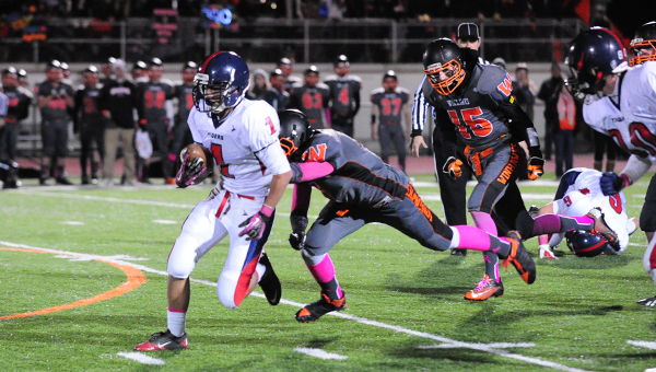 Dereck Samudio of Albert Lea breaks free in the secondary at Winona Tuesday in the Section 1AAAA quarterfinals. Albert Lea lost 47-12.