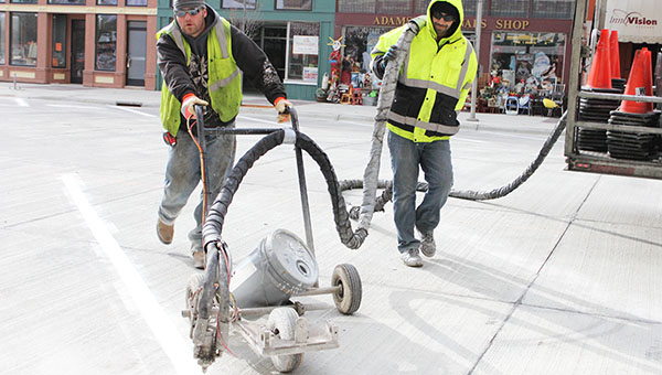 Contractors paint lines for parking stalls Thursday afternoon on Broadway between William Street and Main Street. The block opened today. -- Sarah Stultz/Albert Lea Tribune