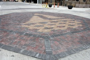 The Albert Lea emblem is featured at the intersection of Broadway and William Street. -- Sarah Stultz/Albert Lea Tribune