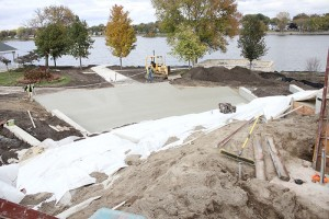 Contractors smooth concrete in Fountain Lake Park Thursday afternoon on what will become a grand staircase in the park. Work is expected to be completed there by the end of November. -- Sarah Stultz/Albert Lea Tribune