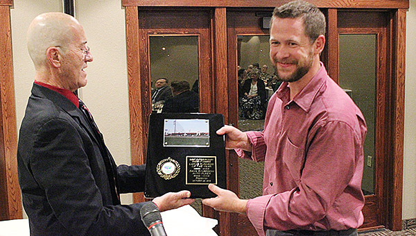 Kade Vershey, general manager of Dave Syverson Auto Center, accepts the award for Large Business of the Year, Thursday evening at Wedgewood Cove during the Albert Lea-Freeborn County Chamber of Commerce annual banquet. Handing him the honor is Randy Kehr, chamber director. -- Tim Engstrom/Albert Lea Tribune