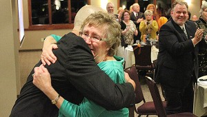 Albert Lea-Freeborn County Chamber of Commerce Executive Director Randy Kehr hugs Volunteer of the Year Rhodette Groe in a touching moment at the chamber's annual banquet Thursday at Wedgewood Cove Golf Club. Groe, with Bookkeeping Cents, helps organize the chamber's annual 4-H livestock auction. -- Tim Engstrom/Albert Lea Tribune