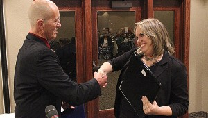 Heather Lee, general manager of Country Inn & Suites on East Main Street in Albert Lea, shakes the hand of Albert Lea-Freeborn County Chamber of Commerce Executive Director Randy Kehr after her business was named Medium Business of the Year. -- Tim Engstrom/Albert Lea Tribune
