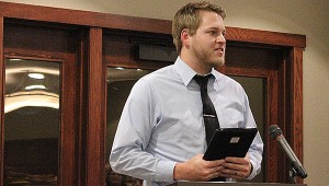 Jonathan Murray accepts a plaque Thursday after being named Ambassador of the Year at the Albert Lea-Freeborn County Chamber of Commerce's annual banquet. -- Tim Engstrom/Albert Lea Tribune