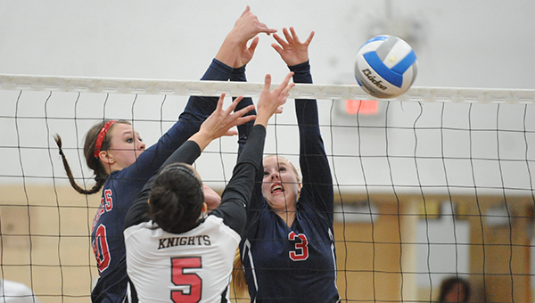 Bailey Olson, left, and Tara Bauman of United South Central block the ball after Alden-Conger's Brittany Waters tried to set the ball over the net. — Micah Bader/Albert Lea Tribune