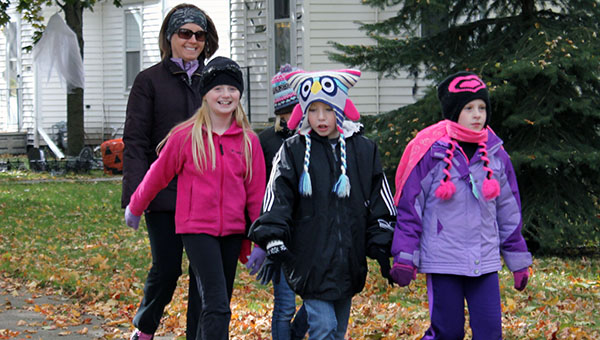 Sibley Elementary School students walk along Lincoln Avenue as part of the Stroll for a Goal walkathon on Thursday. -- Kelli Lageson/Albert Lea Tribune
